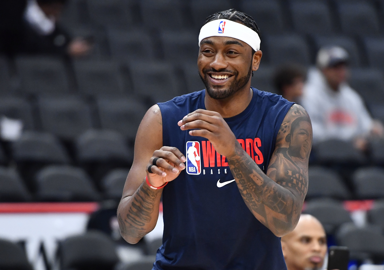 John Wall smiles while practicing