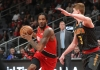Trevor Ariza tries to drive against Kevin Huerter's defense in a Blazers-Hawks game