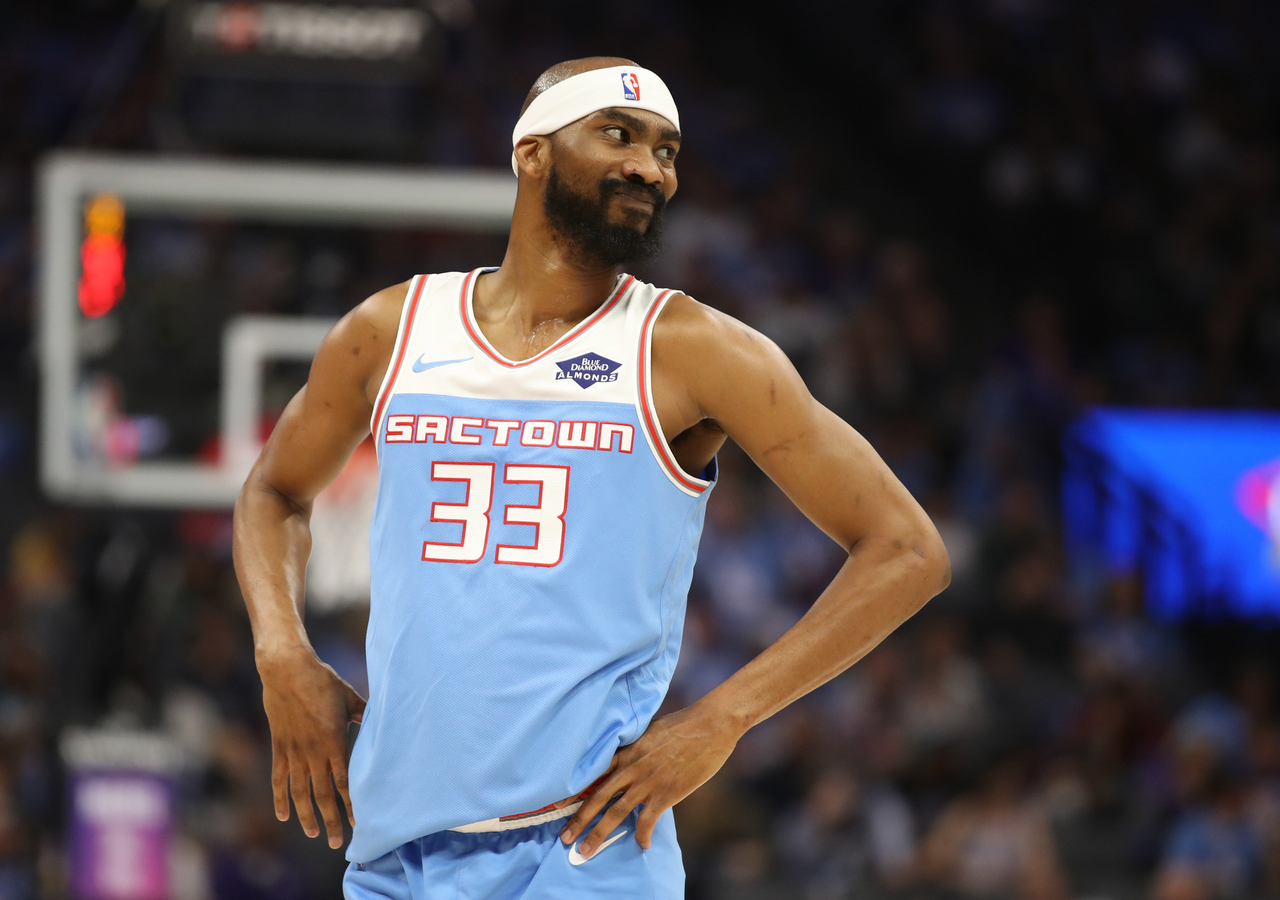 Corey Brewer smiles after a play