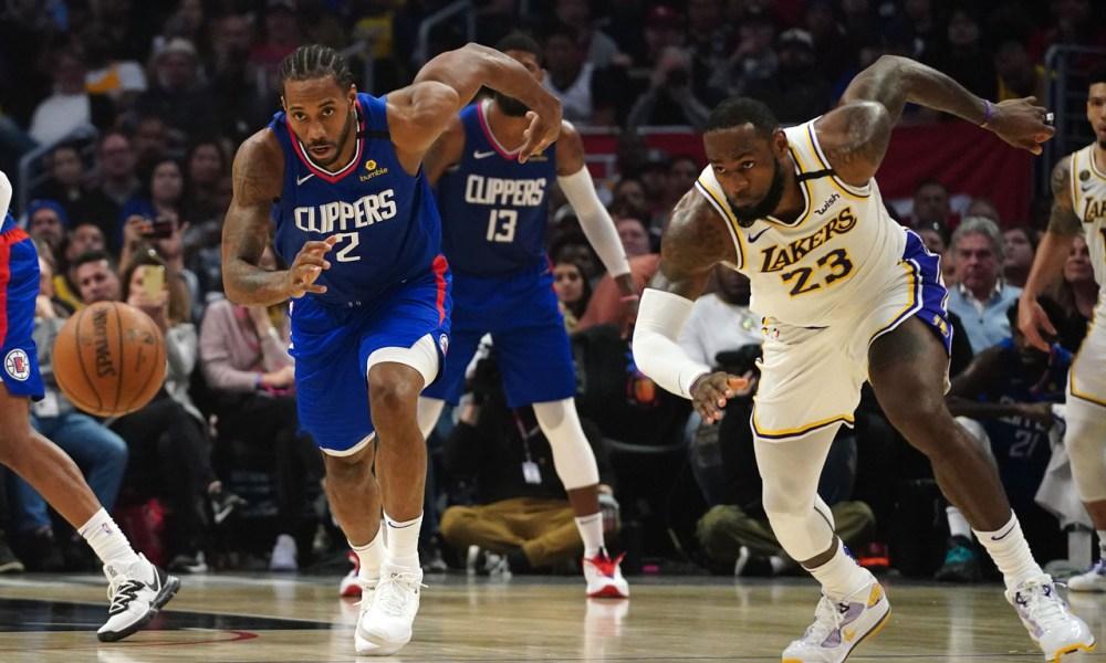 Kawhi Leonard and LeBron James run for the ball