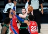 Gordon Hayward defended by two 76ers players