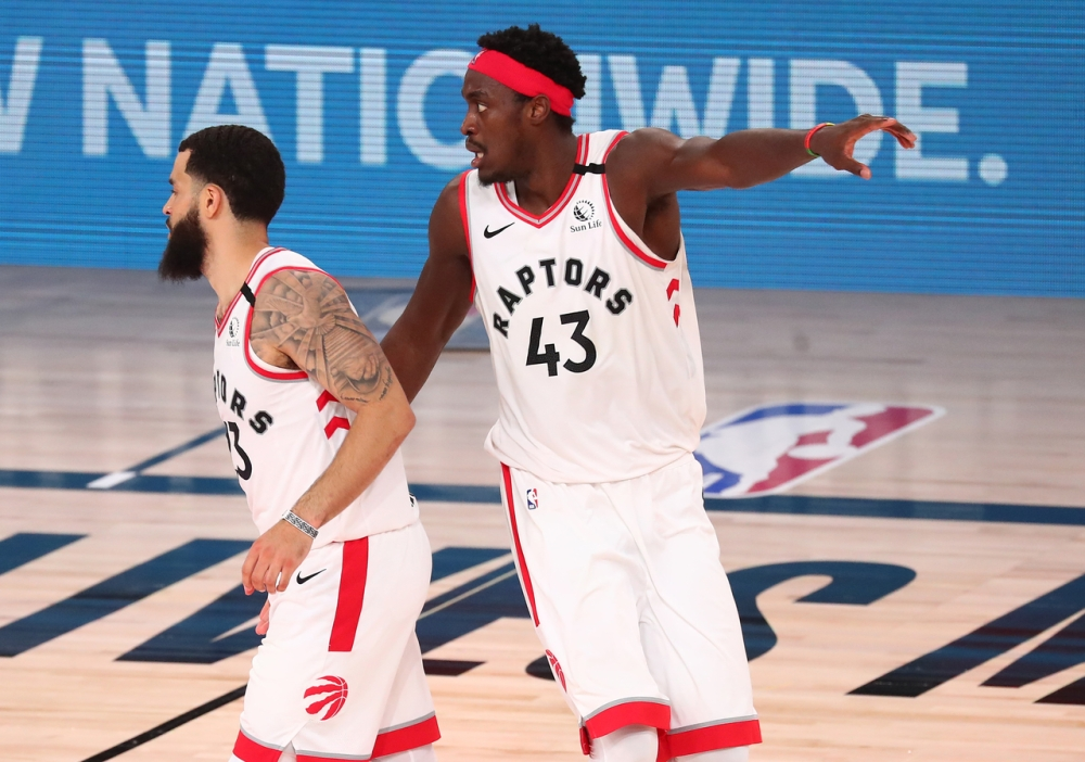 Pascal Siakam gives instructions to his teammates