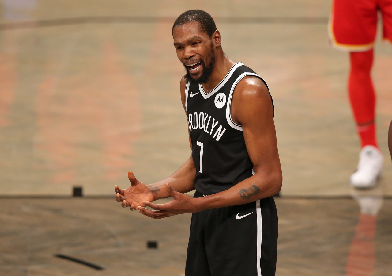 Kevin Durant complains after a call