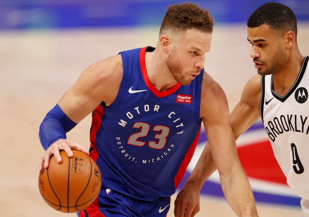 Blake Griffin trying to drive against Timothe Luwawu