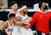 Carmelo Anthony held back by Enes Kanter