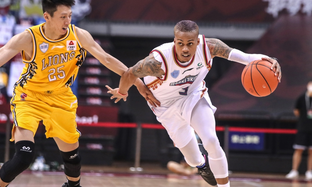 Joseph Young tries to advance the ball in the Chinese CBA