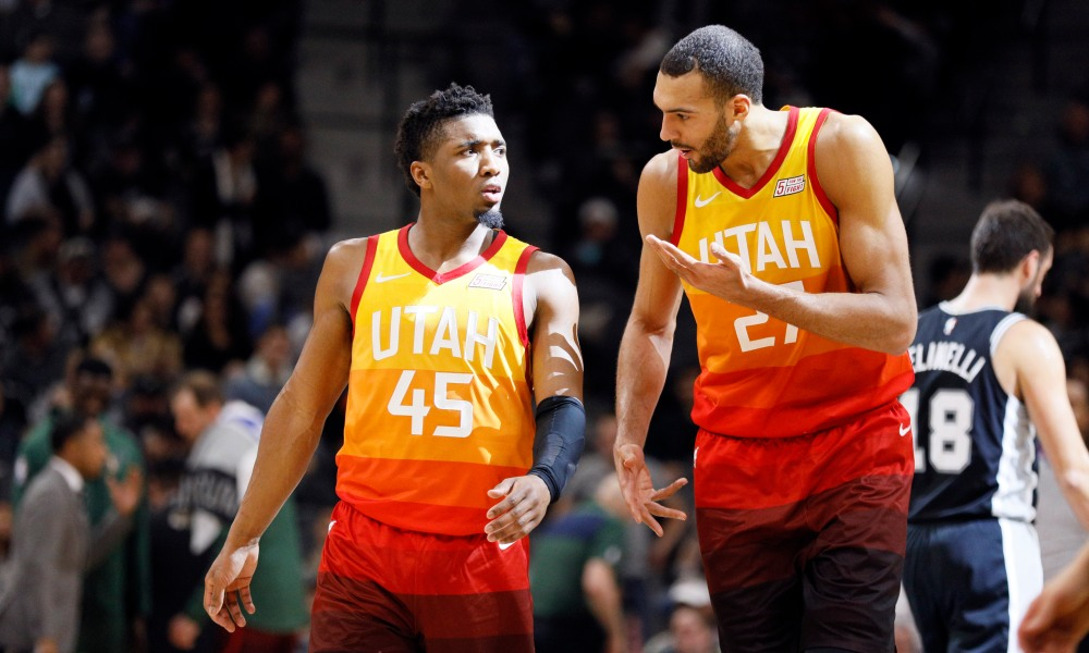 San Antonio, TX, USA; Utah Jazz shooting guard Donovan Mitchell (45) and center Rudy Gobert (27) talk as they walk up the court during the second half against the San Antonio Spurs at AT&T Center.