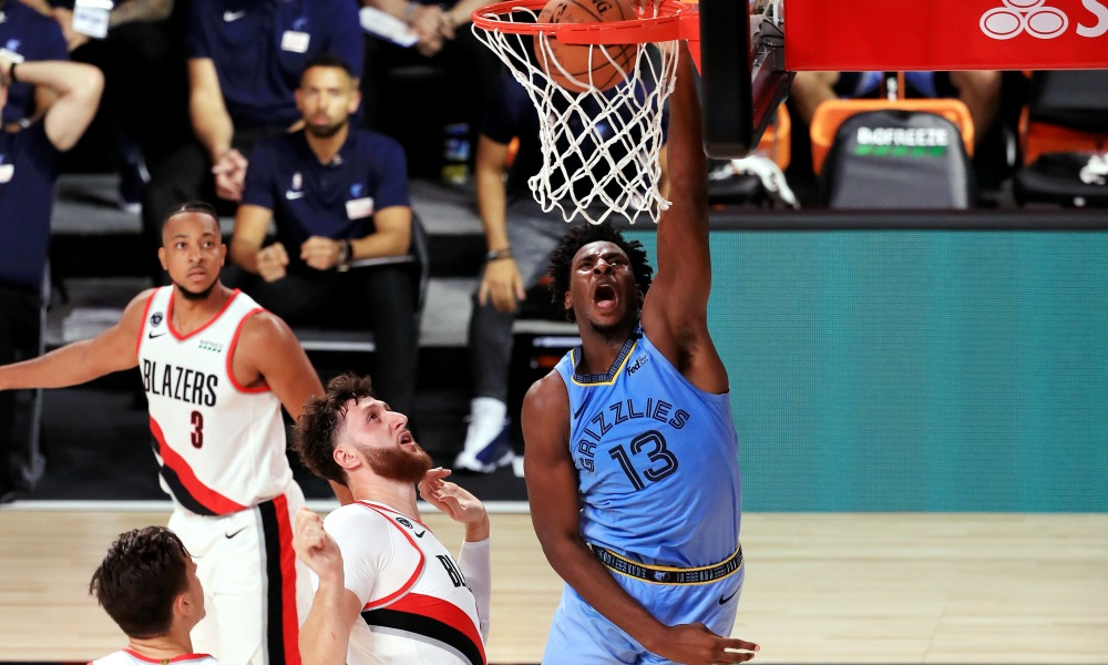 July 31, 2020; Lake Buena Vista, USA; Jaren Jackson Jr. #13 of the Memphis Grizzlies dunks the ball during the second half against the Portland Trail Blazers at The Arena at ESPN Wide World Of Sports Complex on July 31, 2020 in Lake Buena Vista, Florida.