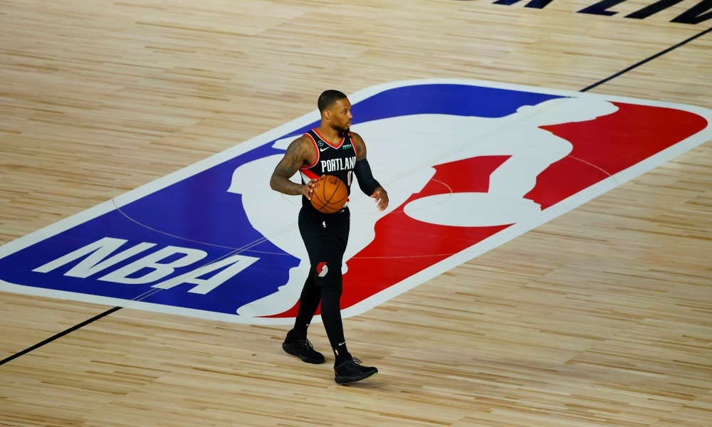Aug 15, 2020; Lake Buena Vista, Florida, USA; Damian Lillard #0 of the Portland Trail Blazers moves the ball up court against the Memphis Grizzlies during the first quarter in the Western Conference play-in game one at The Field House.