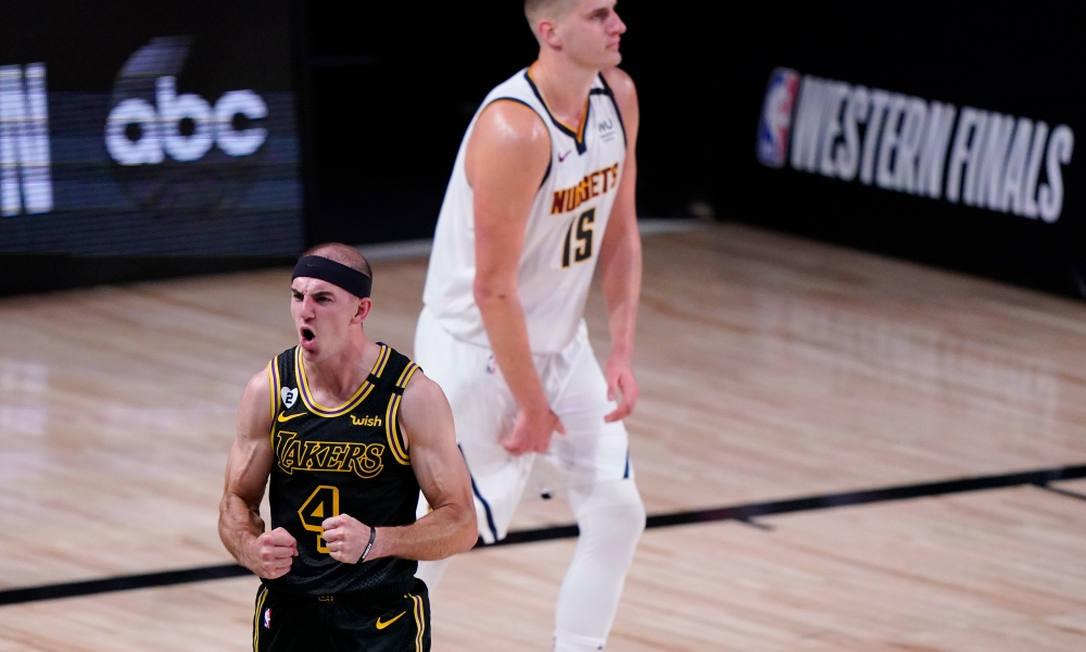 Los Angeles Lakers' Alex Caruso (4) celebrates in front of Denver Nuggets' Nikola Jokic (15) during the second half of an NBA conference final playoff basketball game Sunday, Sept. 20, 2020, in Lake Buena Vista, Fla.