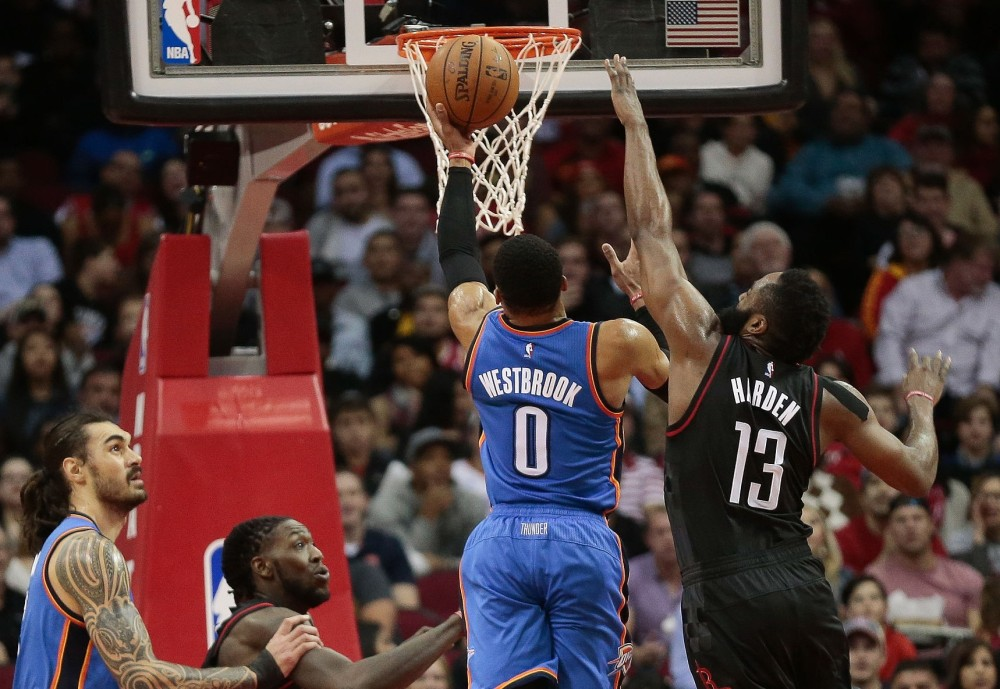 Russell Westbrook drives past James Harden