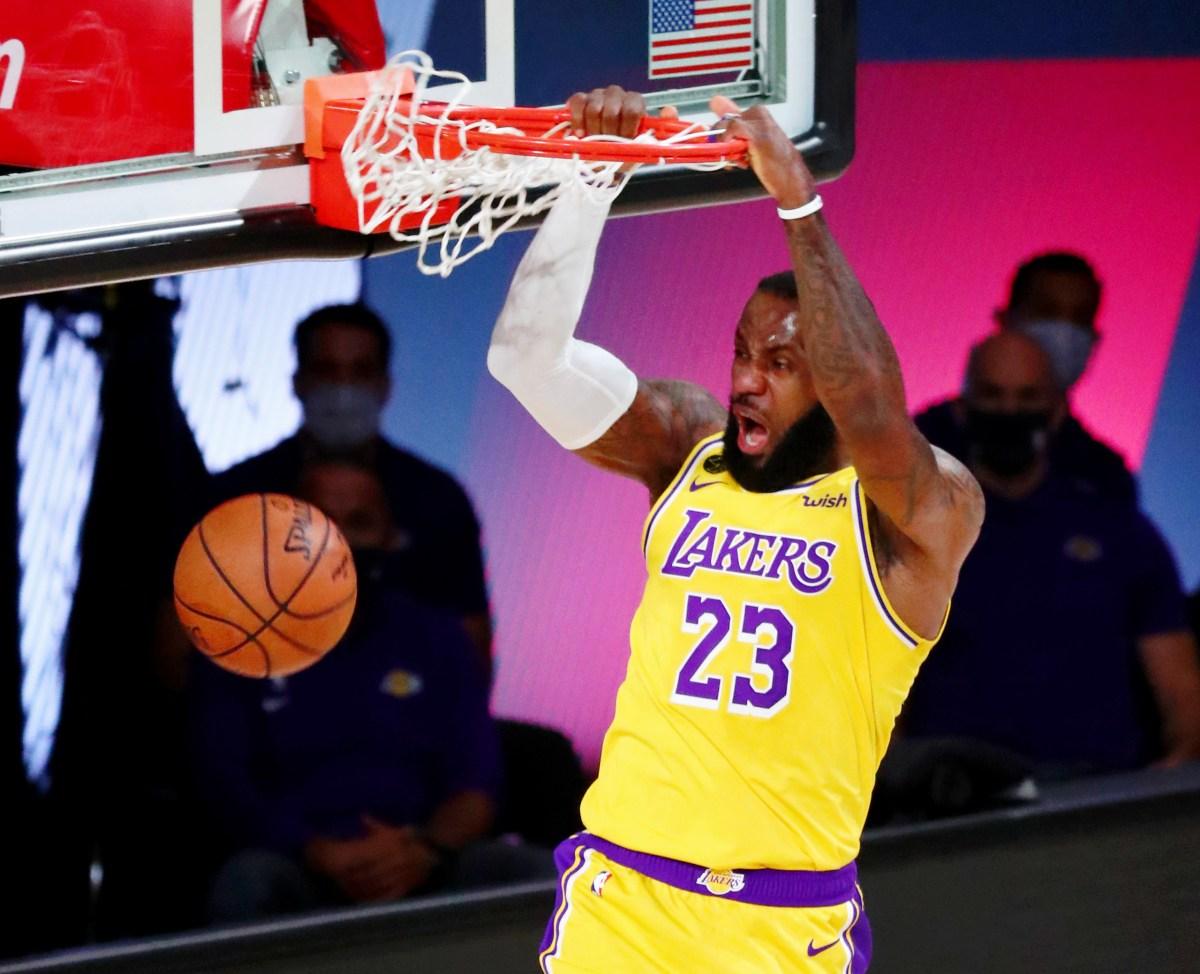 LeBron James dunks the ball
