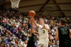 West Linn's Payton Pritchard drives on Jesuit's Malcolm Porter as Jesuit plays West Linn for the 6A Basketball State Championship at the Chiles Center in Portland, Ore. on Saturday, March 14, 2015.