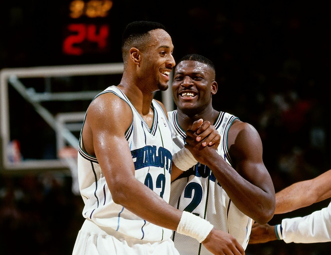 Alonzo Mourning and Larry Johnson