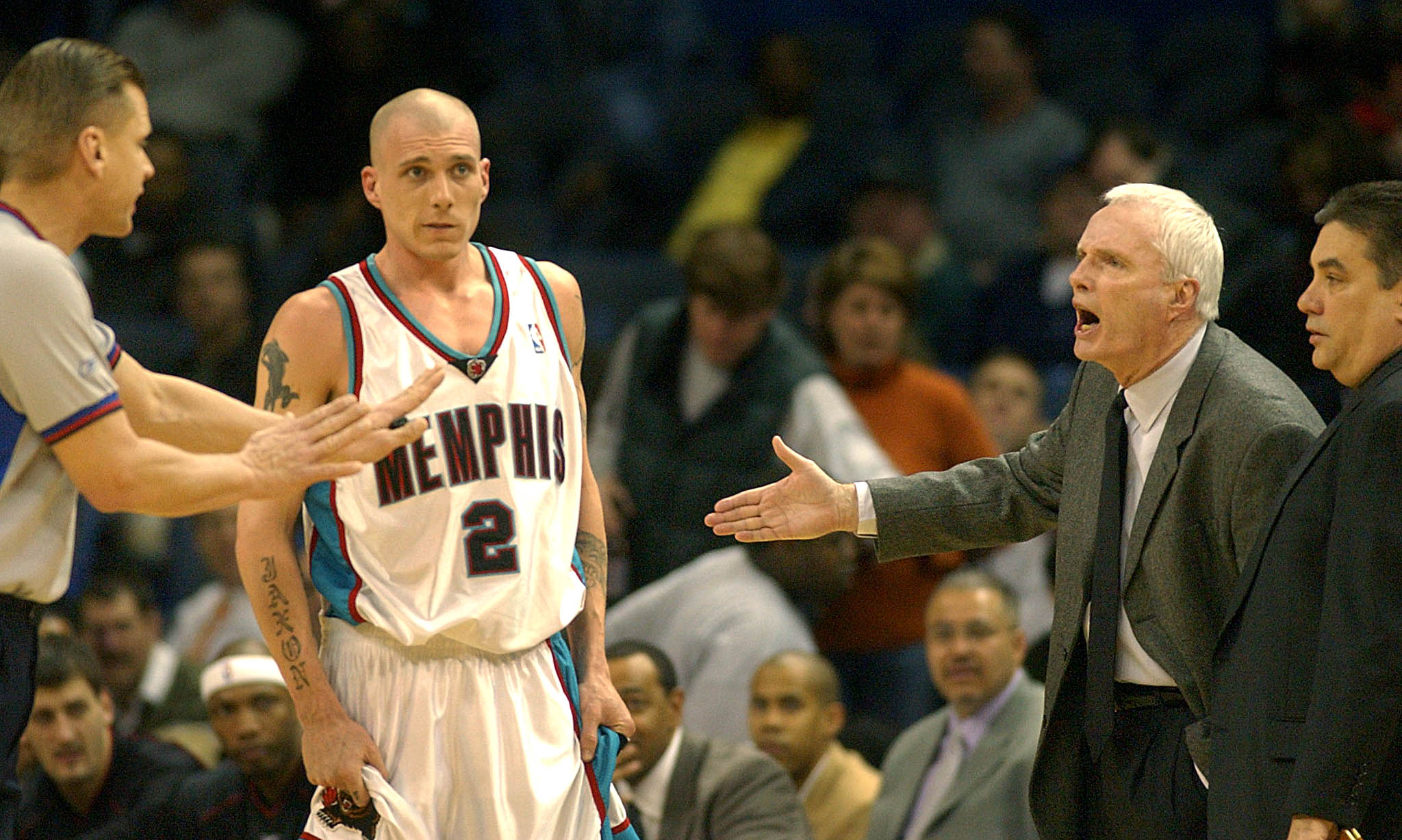 Memphis Grizzlies' head coach Hubie Brown (R) argues his first technical with official Steve Javie (L) during first quarter NBA action 18 February 2003 at the Pyramid in Memphis, TN. Brown was given a second technical and ejected from the game. AFP PHOTO/Matthew CRAIG (Photo by MATTHEW CRAIG / AFP)