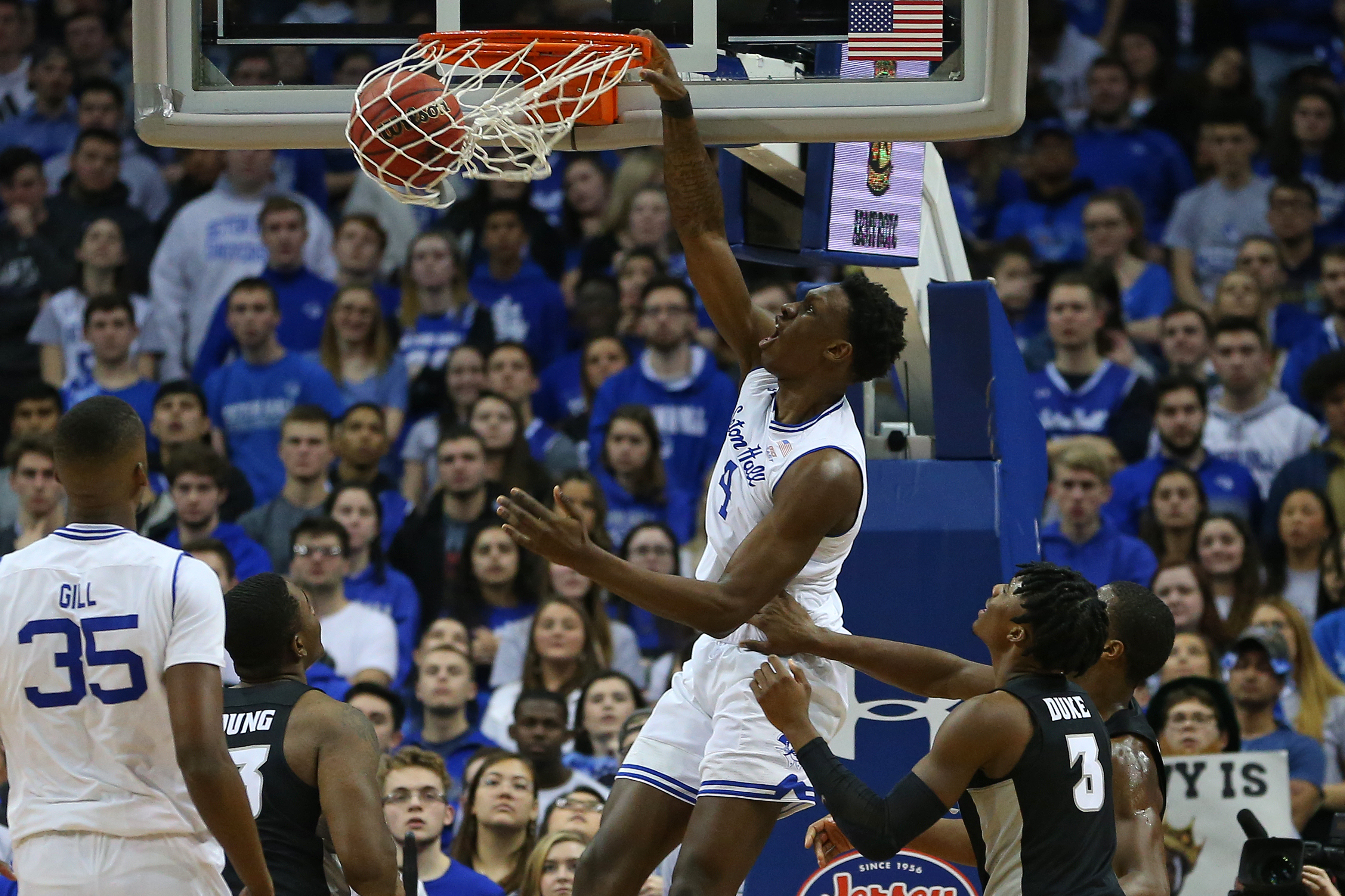 NEWARK, NJ - JANUARY 22: Tyrese Samuel #4 of the Seton Hall Pirates dunks over David Duke #3 and Greg Gantt #1 of the Providence Friars during the first half of a college basketball game at Prudential Center on January 22, 2020 in Newark, New Jersey.