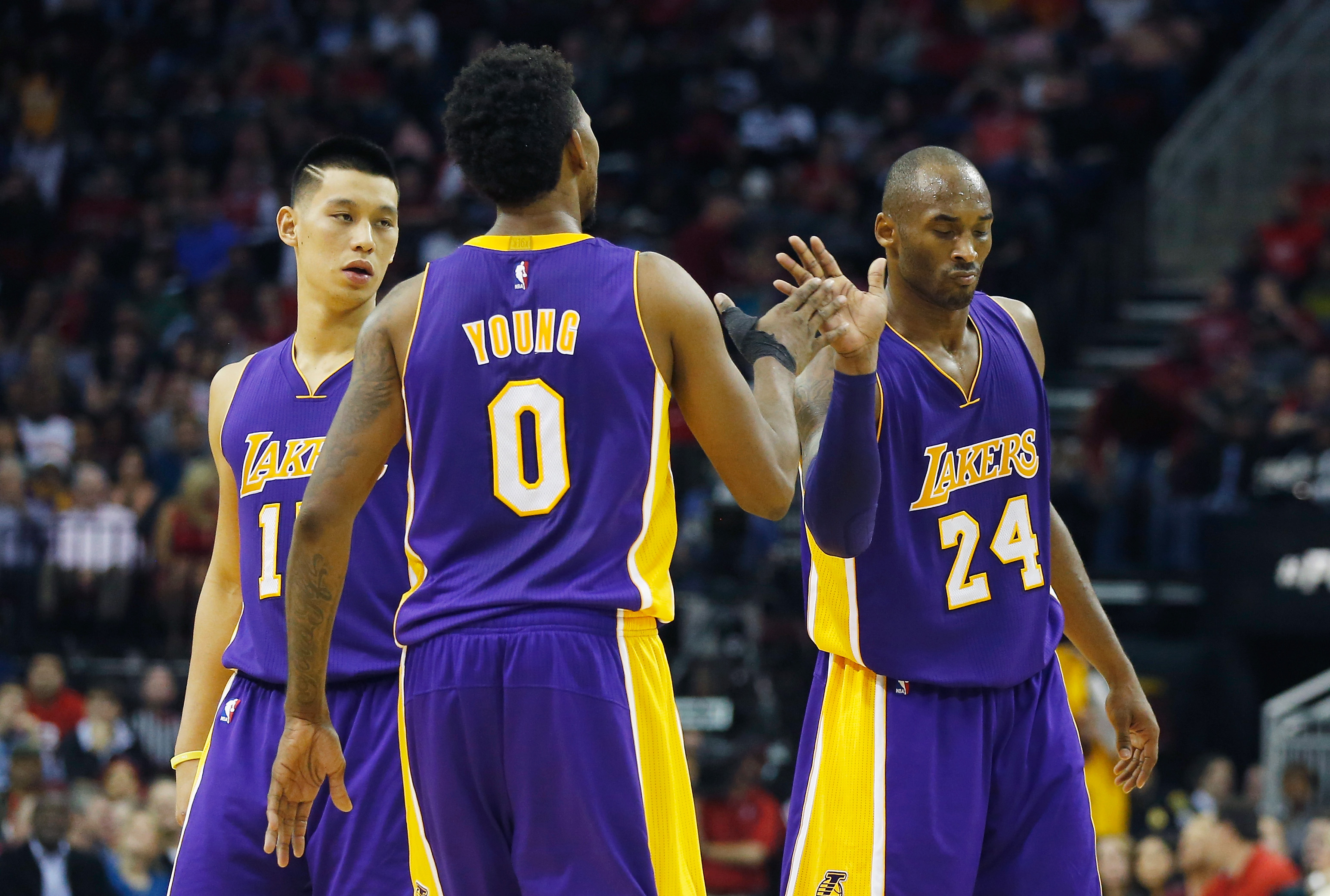 HOUSTON, TX - NOVEMBER 19: Kobe Bryant #24 of the Los Angeles Lakers celebrates a play with Jeremy Lin #17 and Nick Young #0 during their game against the Houston Rockets at the Toyota Center on November 19, 2014 in Houston, Texas. NOTE TO USER: User expressly acknowledges and agrees that, by downloading and/or using this photograph, user is consenting to the terms and conditions of the Getty Images License Agreement.