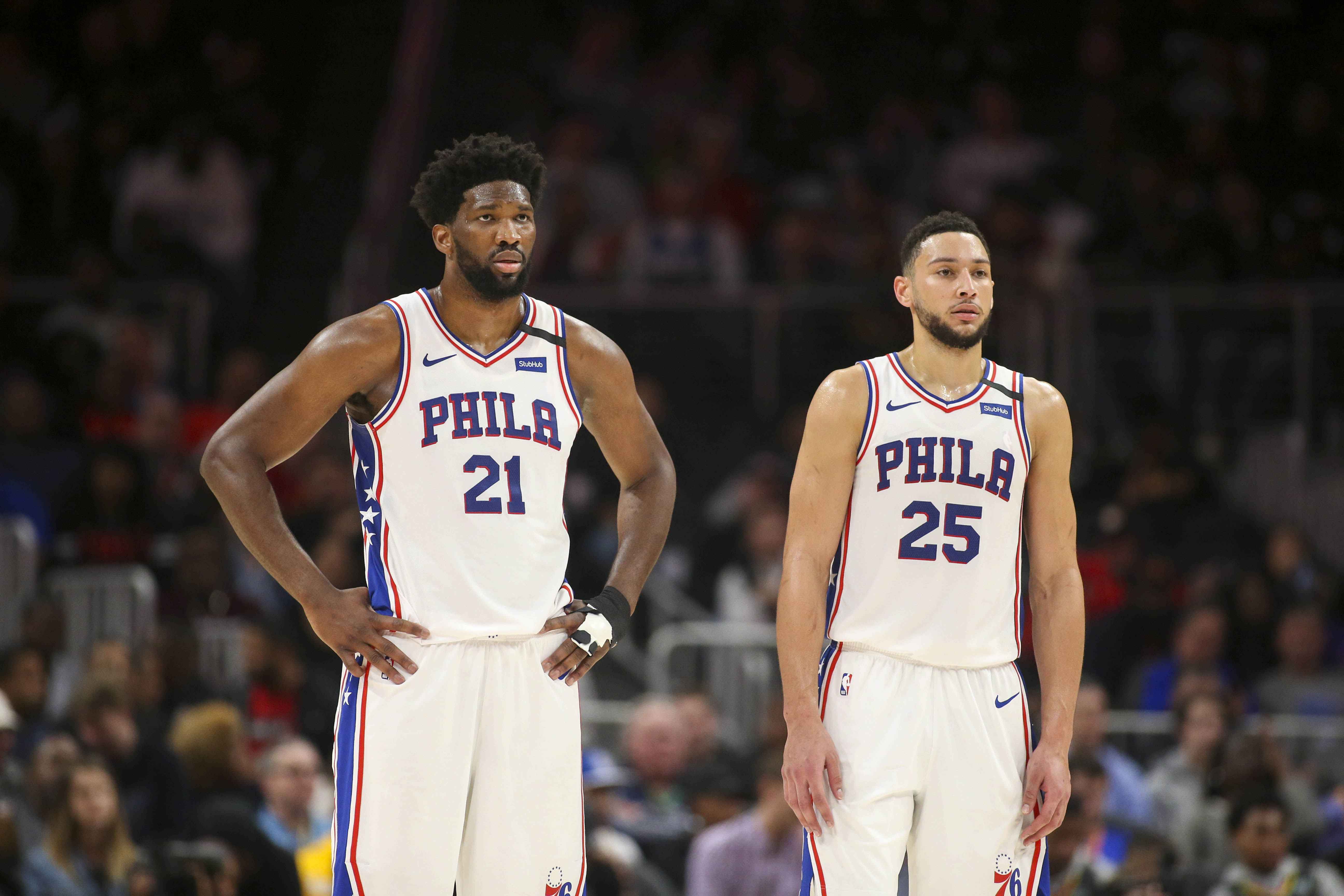 Jan 30, 2020; Atlanta, Georgia, USA; Philadelphia 76ers center Joel Embiid (21) and guard Ben Simmons (25) during a free throw against the Atlanta Hawks in the second quarter at State Farm Arena.