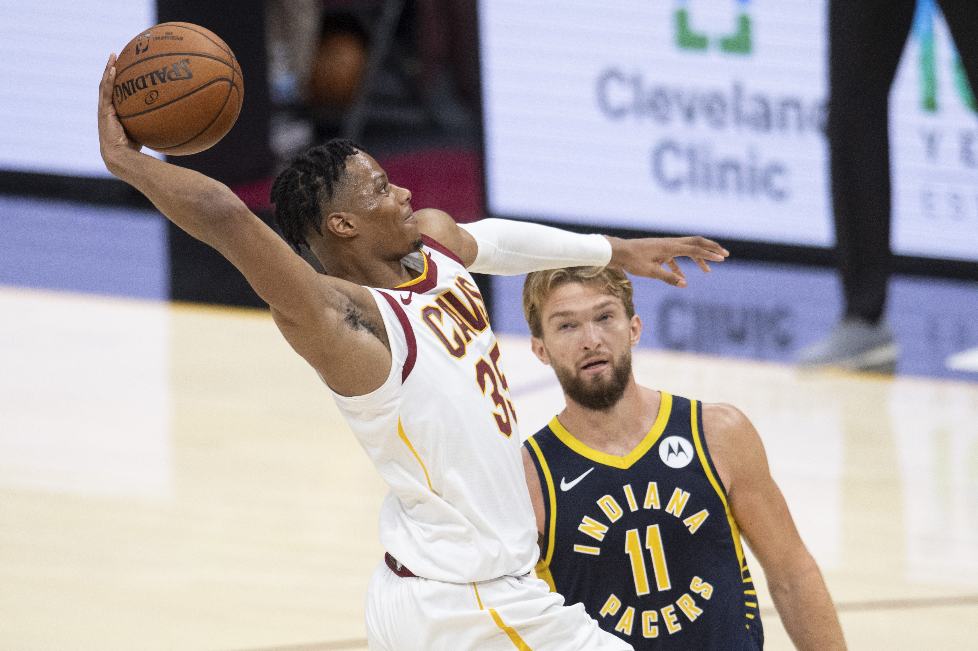 Dec 12, 2020; Cleveland, Ohio, USA; Cleveland Cavaliers guard Isaac Okoro (35) drives to the basket against Indiana Pacers forward Domantas Sabonis (11) during the third quarter at Rocket Mortgage FieldHouse.
