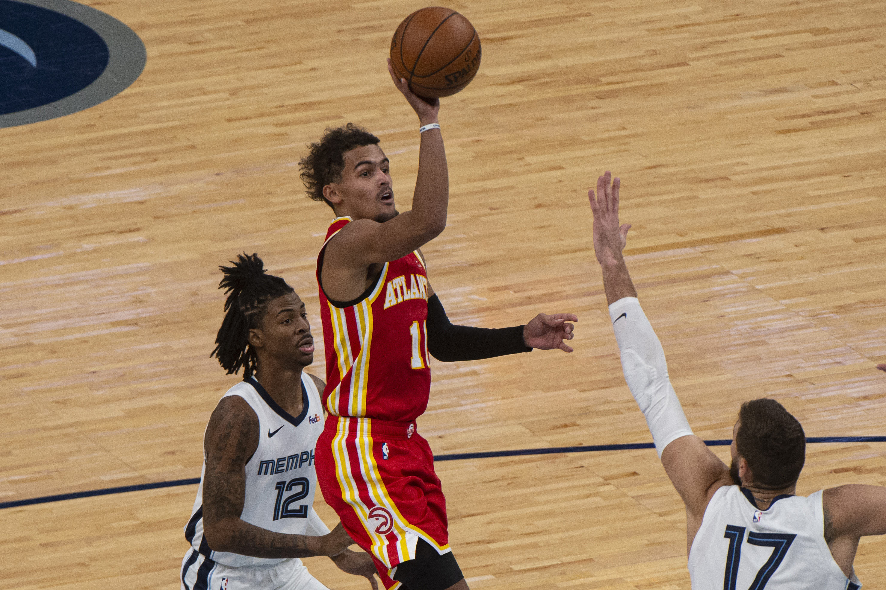 Dec 17, 2020; Memphis, Tennessee, USA; Atlanta Hawks guard Trae Young (11) goes to the basket against Memphis Grizzlies center Jonas Valanciunas (17) during the second half at FedExForum.