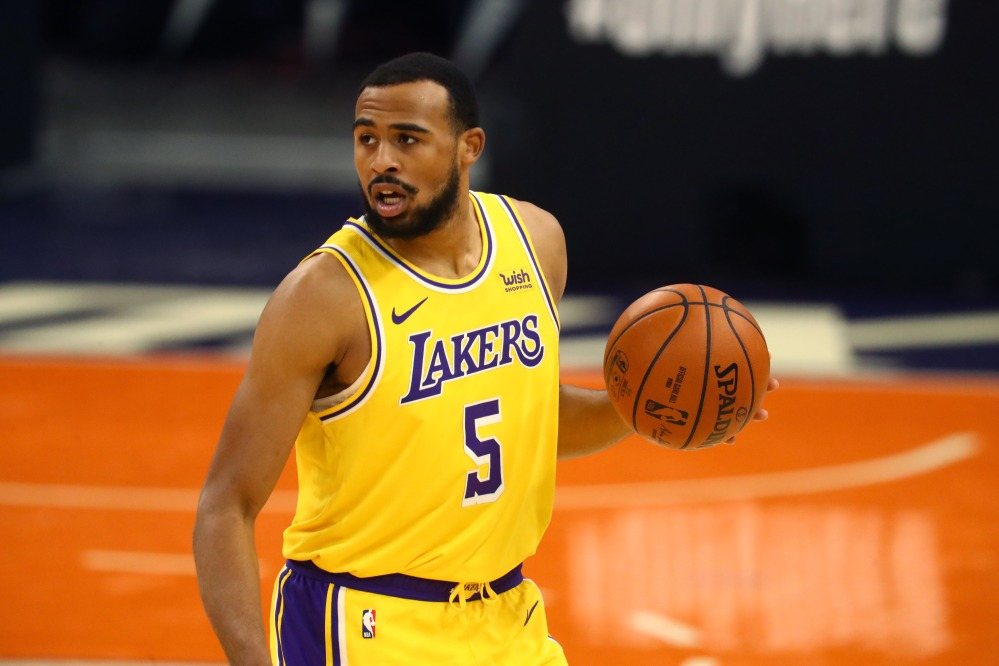 Dec 18, 2020; Phoenix, Arizona, USA; Los Angeles Lakers guard Talen Horton-Tucker (5) against the Phoenix Suns during a preseason game at Phoenix Suns Arena.