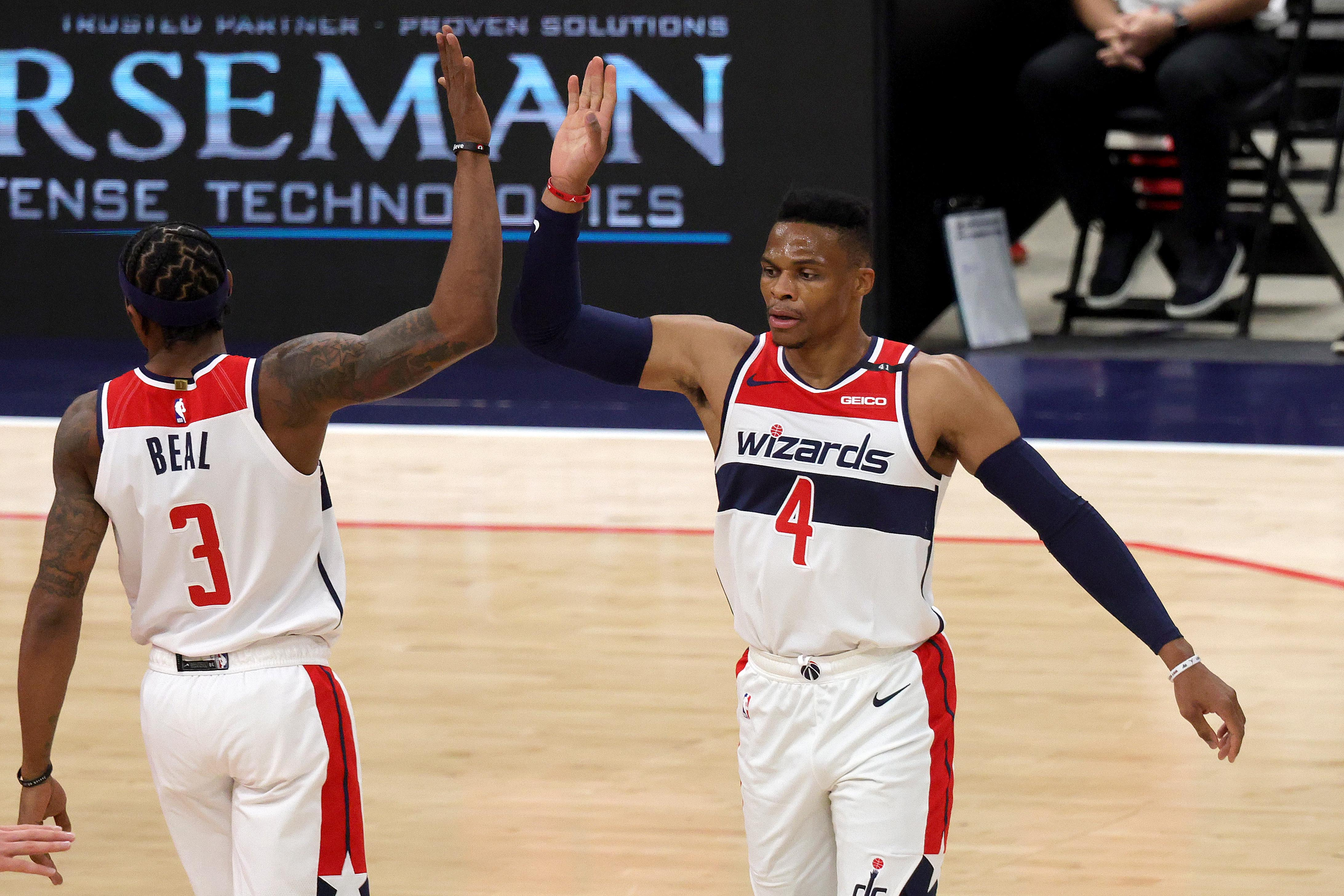 Dec 19, 2020; Washington, DC, USA; Bradley Beal #3 and Russell Westbrook #4 of the Washington Wizards celebrate after Beal scored and was fouled in the first half of a preseason game against the Detroit Pistons at Capital One Arena on December 19, 2020 in Washington, DC