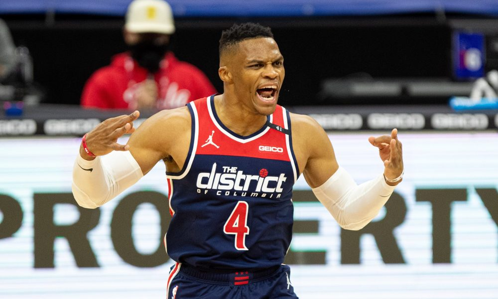 Dec 23, 2020; Philadelphia, Pennsylvania, USA; Washington Wizards guard Russell Westbrook (4) reacts after assisting on a three point score against the Philadelphia 76ers during the third quarter at Wells Fargo Center.