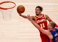 Dec 28, 2020; Atlanta, Georgia, USA; Atlanta Hawks guard Trae Young (11) scores past Detroit Pistons center Mason Plumlee (24) during the second half at State Farm Arena.