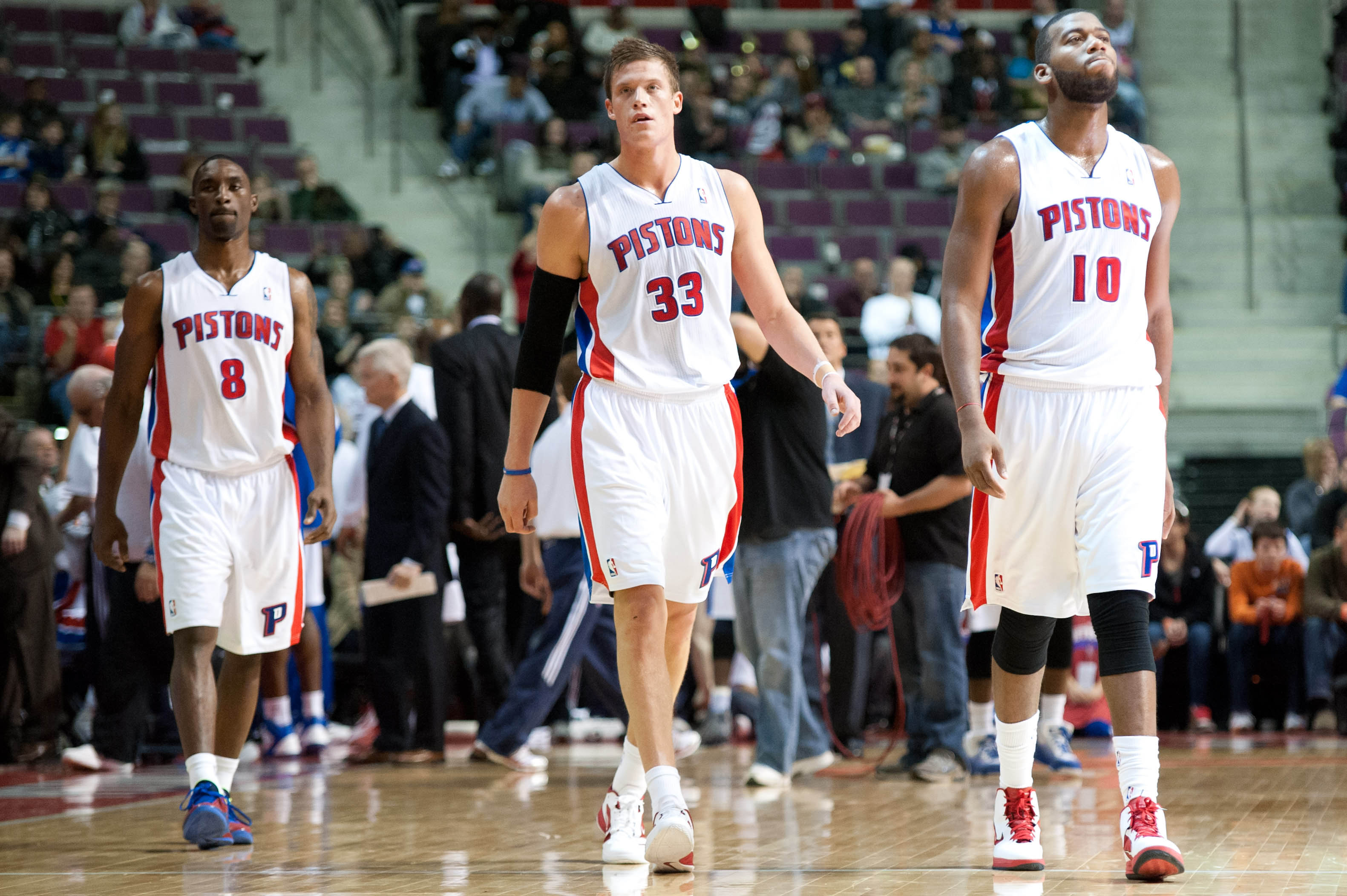 Dec 31, 2011; Auburn Hills, MI, USA; Detroit Pistons power forward Greg Monroe (10), forward Jonas Jerebko (33) and shooting guard Ben Gordon (8) during the second half against the Indiana Pacers at The Palace. Detroit won 96-88.