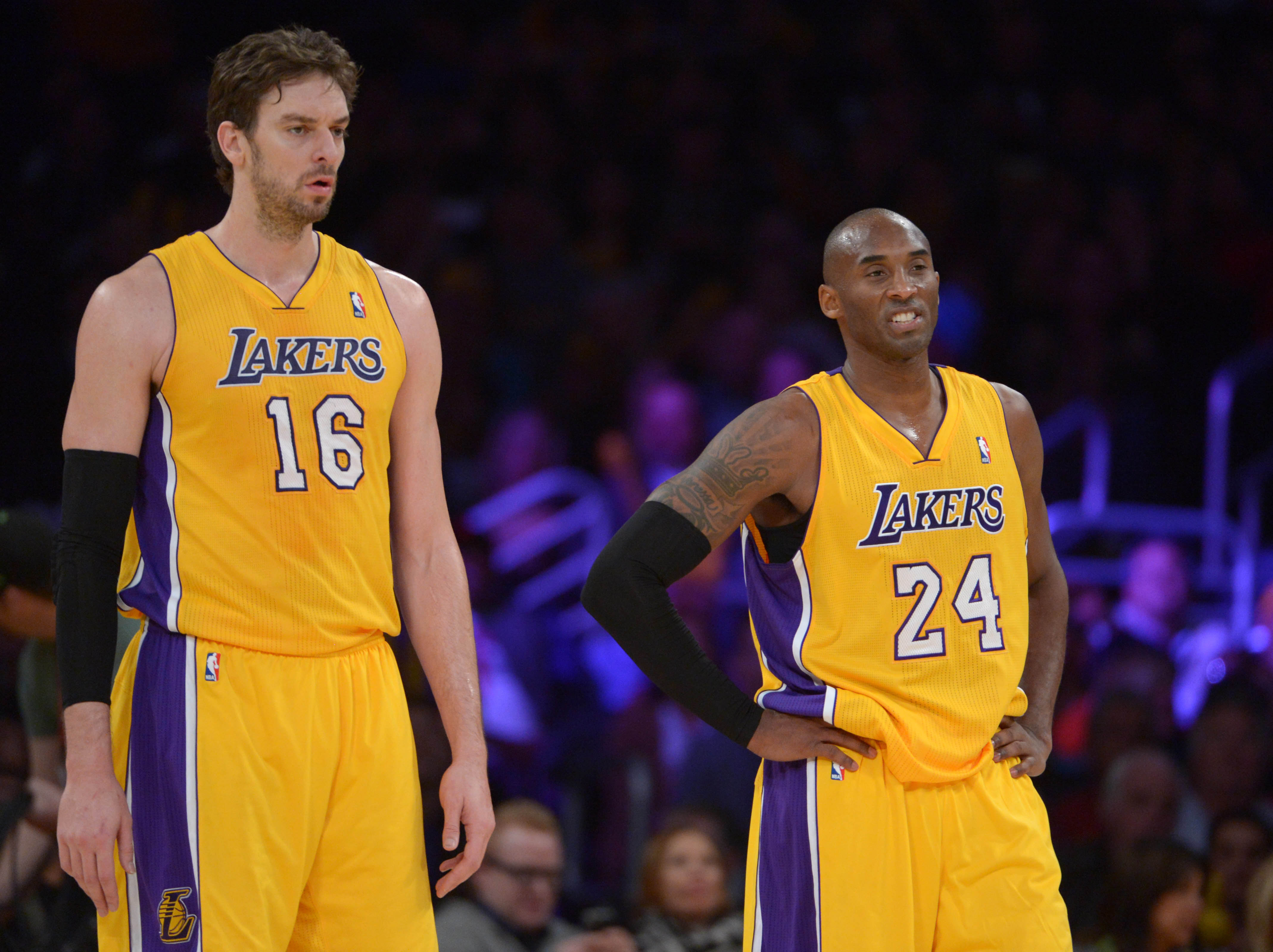 Dec 10, 2013; Los Angeles, CA, USA; Los Angeles Lakers forward Pau Gasol (16) and guard Kobe Bryant (24) react during the game against the Phoenix Suns at Staples Center. The Suns defeated the Lakers 114-108.