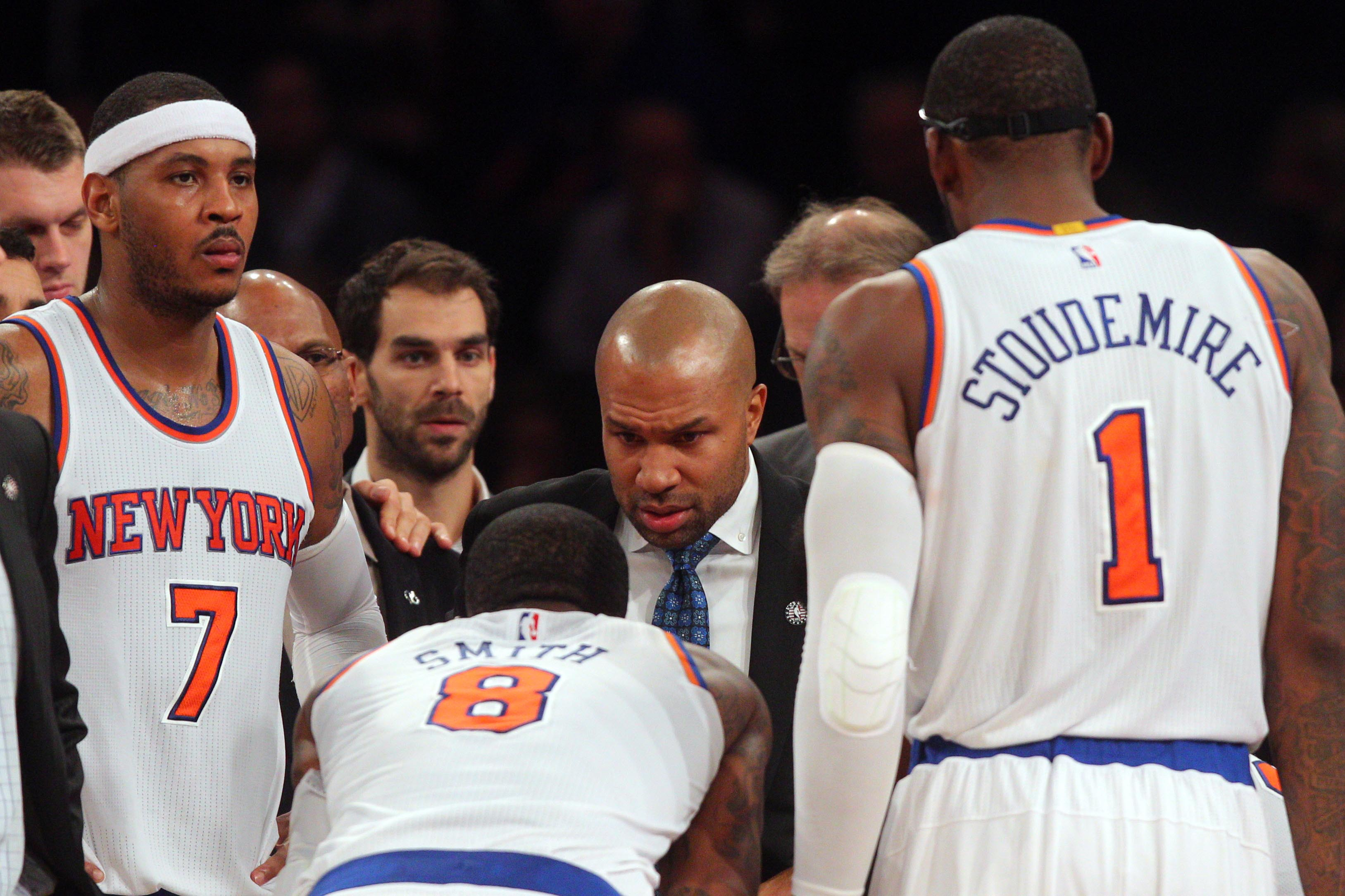 Nov 10, 2014; New York, NY, USA; New York Knicks head coach Derek Fisher coaches New York Knicks small forward Carmelo Anthony (7) and New York Knicks shooting guard J.R. Smith (8) and New York Knicks power forward Amar'e Stoudemire (1) against the Atlanta Hawks during the fourth quarter at Madison Square Garden. The Hawks defeated the Knicks 91-85.
