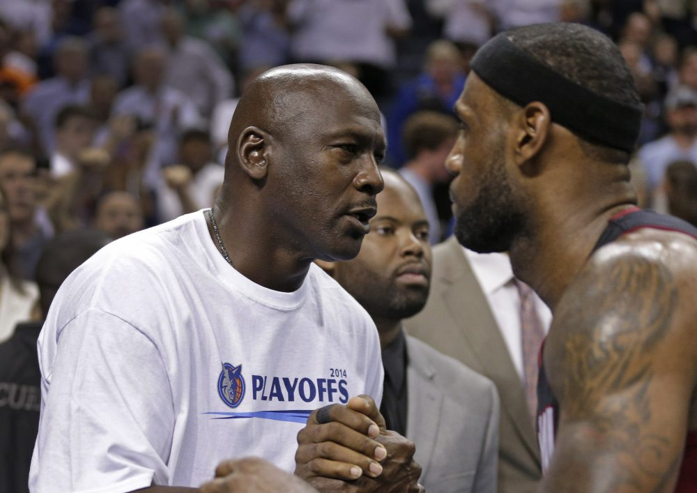 Charlotte Bobcats owner Michael Jordan, left, shakes hands with Miami Heat's LeBron James, right, after Game 4 of an opening-round NBA basketball playoff series in Charlotte, N.C., Monday, April 28, 2014. The Heat won 109-98, sweeping the series.