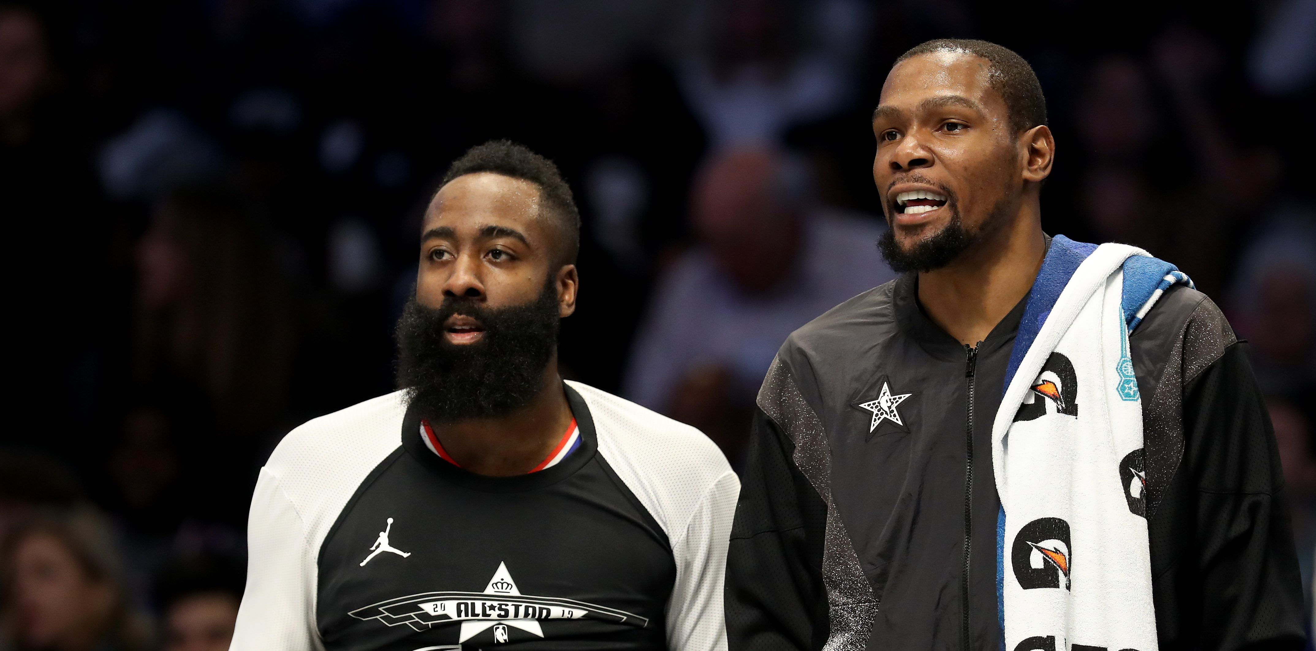 CHARLOTTE, NC - Feb. 17: James Harden, 13th-place Houston Rockets and team-mate Kevin Durant # 35 from Golden State War. Riers and Team LeBron watch from the bench during the NBA All-Star game as part of the 2019 NBA All-Star Weekend at Spectrum Center on February 17, 2019 in Charlotte, North Carolina. Note to users: User expressly acknowledges and agrees that by downloading and / or using this photo, user agrees to the terms and conditions of the Getty Images license agreement.