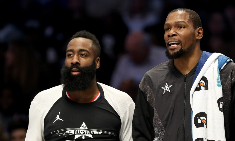 CHARLOTTE, NORTH CAROLINA - FEBRUARY 17: James Harden #13 of the Houston Rockets and teammate Kevin Durant #35 of the Golden State Warriors and Team LeBron watch on from the bench during the NBA All-Star game as part of the 2019 NBA All-Star Weekend at Spectrum Center on February 17, 2019 in Charlotte, North Carolina. NOTE TO USER: User expressly acknowledges and agrees that, by downloading and/or using this photograph, user is consenting to the terms and conditions of the Getty Images License Agreement.