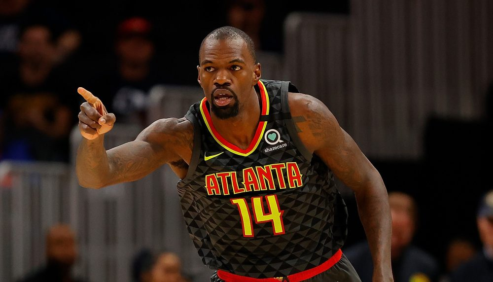 ATLANTA, GEORGIA - FEBRUARY 09: Dewayne Dedmon #14 of the Atlanta Hawks reacts after dunking against the New York Knicks in the first half at State Farm Arena on February 09, 2020 in Atlanta, Georgia. NOTE TO USER: User expressly acknowledges and agrees that, by downloading and/or using this photograph, user is consenting to the terms and conditions of the Getty Images License Agreement.
