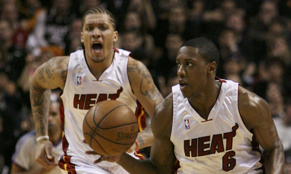 MIAMI - MAY 01: Mario Chalmers #6 of the Miami Heat brings the ball into the front court followed by teammate Michael Beasley #30 while taking on the Atlanta Hawks during Game Six of the Eastern Conference Quarterfinals at American Airlines Arena on May 1, 2009 in Miami, Florida.