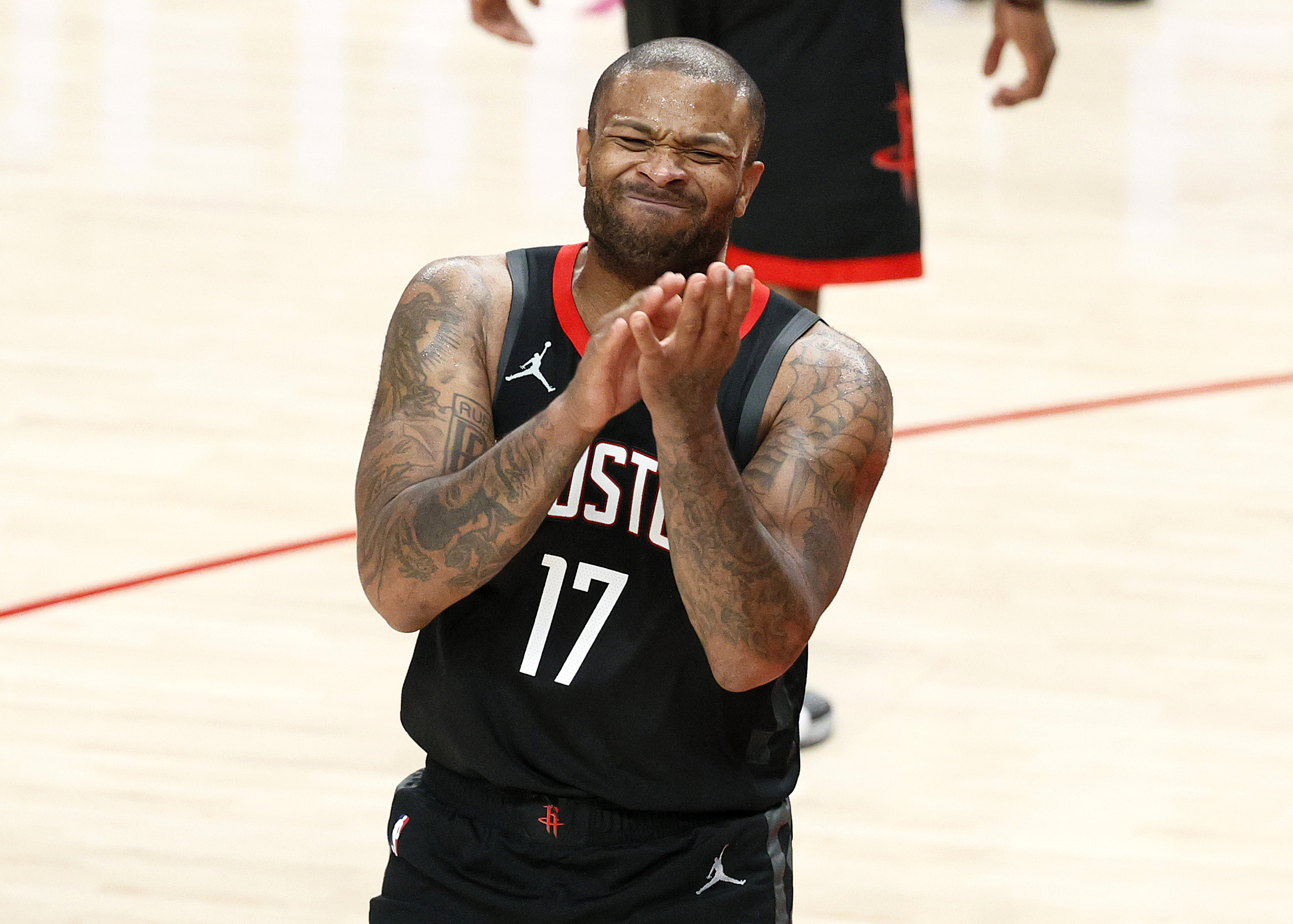 PORTLAND, OREGON - DECEMBER 26: P.J. Tucker #17 of the Houston Rockets reacts after he is called for a foul against the Portland Trail Blazers during the third quarter at Moda Center on December 26, 2020 in Portland, Oregon. NOTE TO USER: User expressly acknowledges and agrees that, by downloading and/or using this photograph, user is consenting to the terms and conditions of the Getty Images License Agreement.