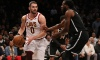 Mar 25, 2018; Brooklyn, NY, USA; Cleveland Cavaliers center Kevin Love (0) controls the ball against Brooklyn Nets small forward DeMarre Carroll (9) during the first quarter at Barclays Center.
