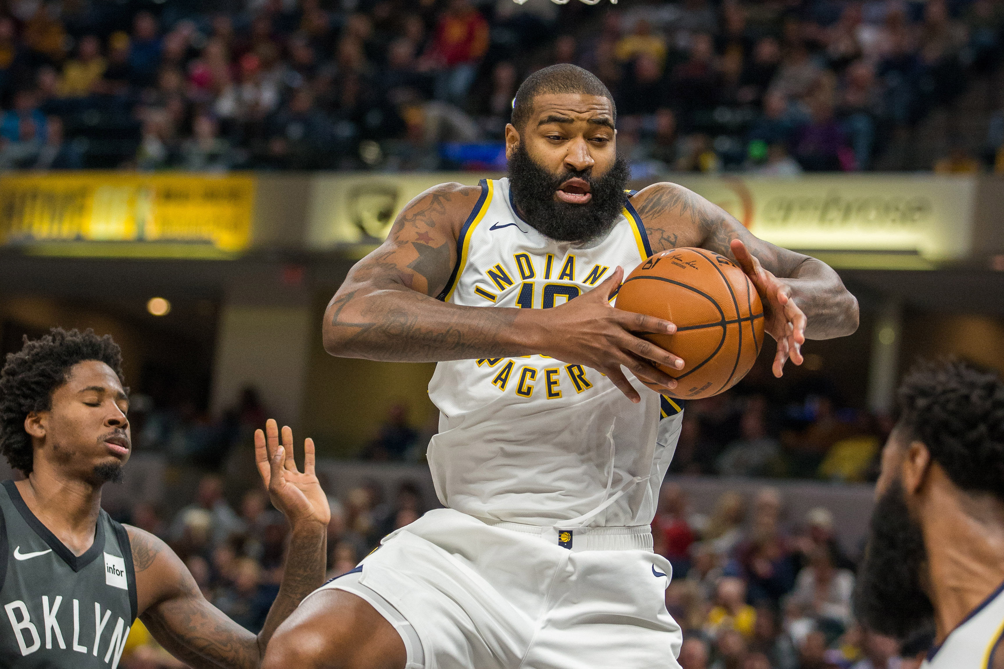 Oct 20, 2018; Indianapolis, IN, USA; Indiana Pacers center Kyle O'Quinn (10) rebounds the ball in the second half against the Brooklyn Nets at Bankers Life Fieldhouse.