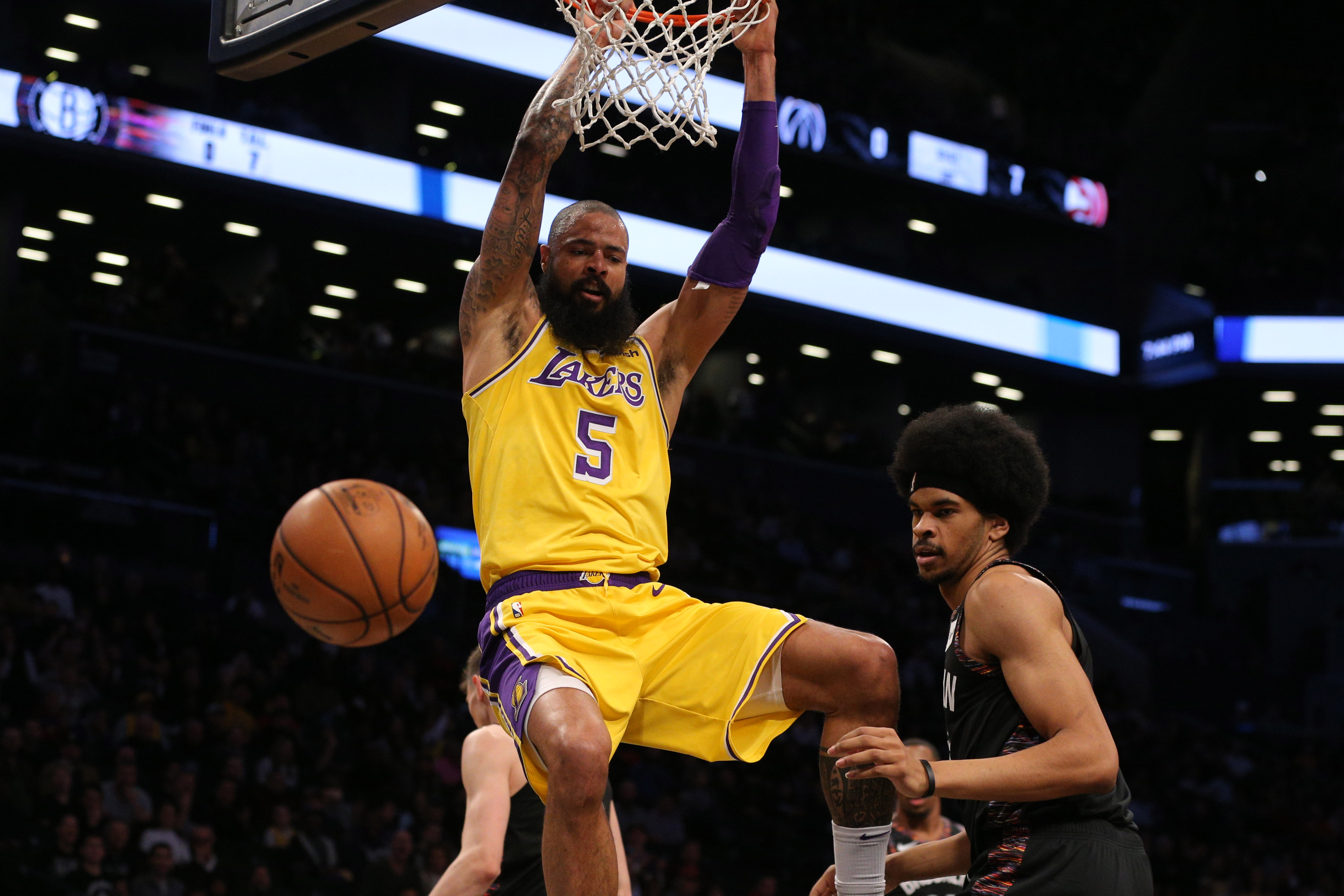 Dec 18, 2018; Brooklyn, NY, USA; Los Angeles Lakers center Tyson Chandler (5) dunks against Brooklyn Nets center Jarrett Allen (31) during the first quarter at Barclays Center.