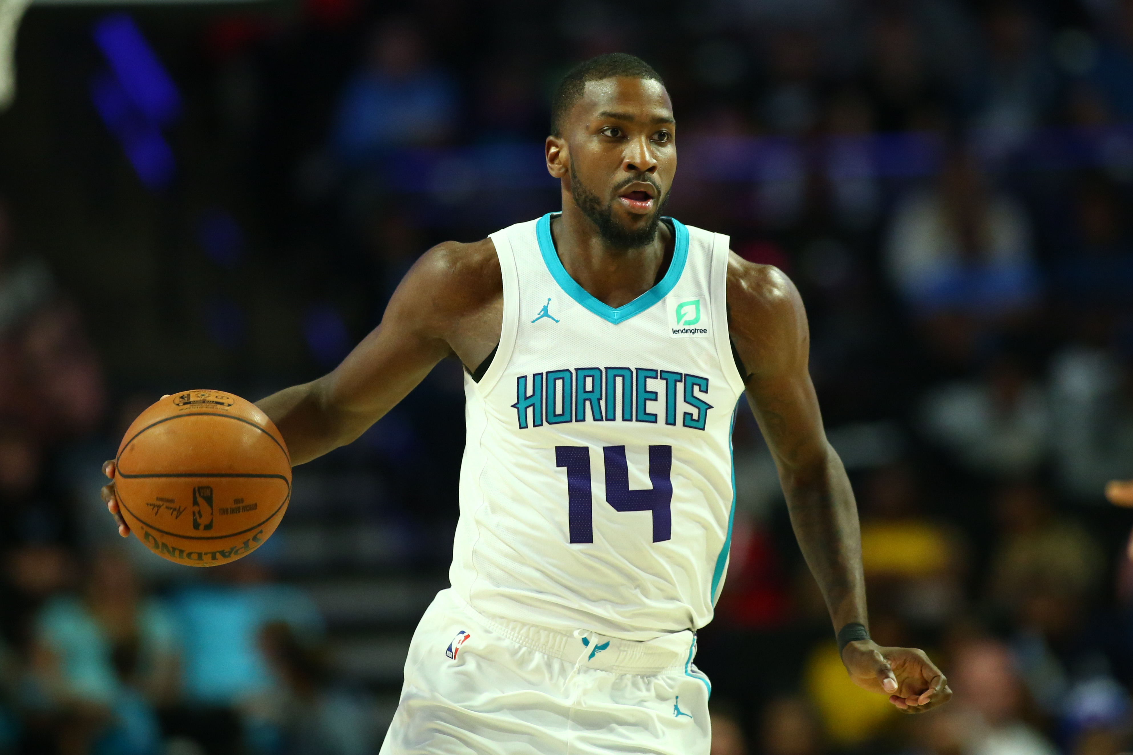 Oct 11, 2019; Winston-Salem, NC, USA; Charlotte Hornets forward Michael Kidd-Gilchrist (14) sets up a play during the game against the Philadelphia 76ers at Lawrence Joel Veterans Memorial Coliseum.