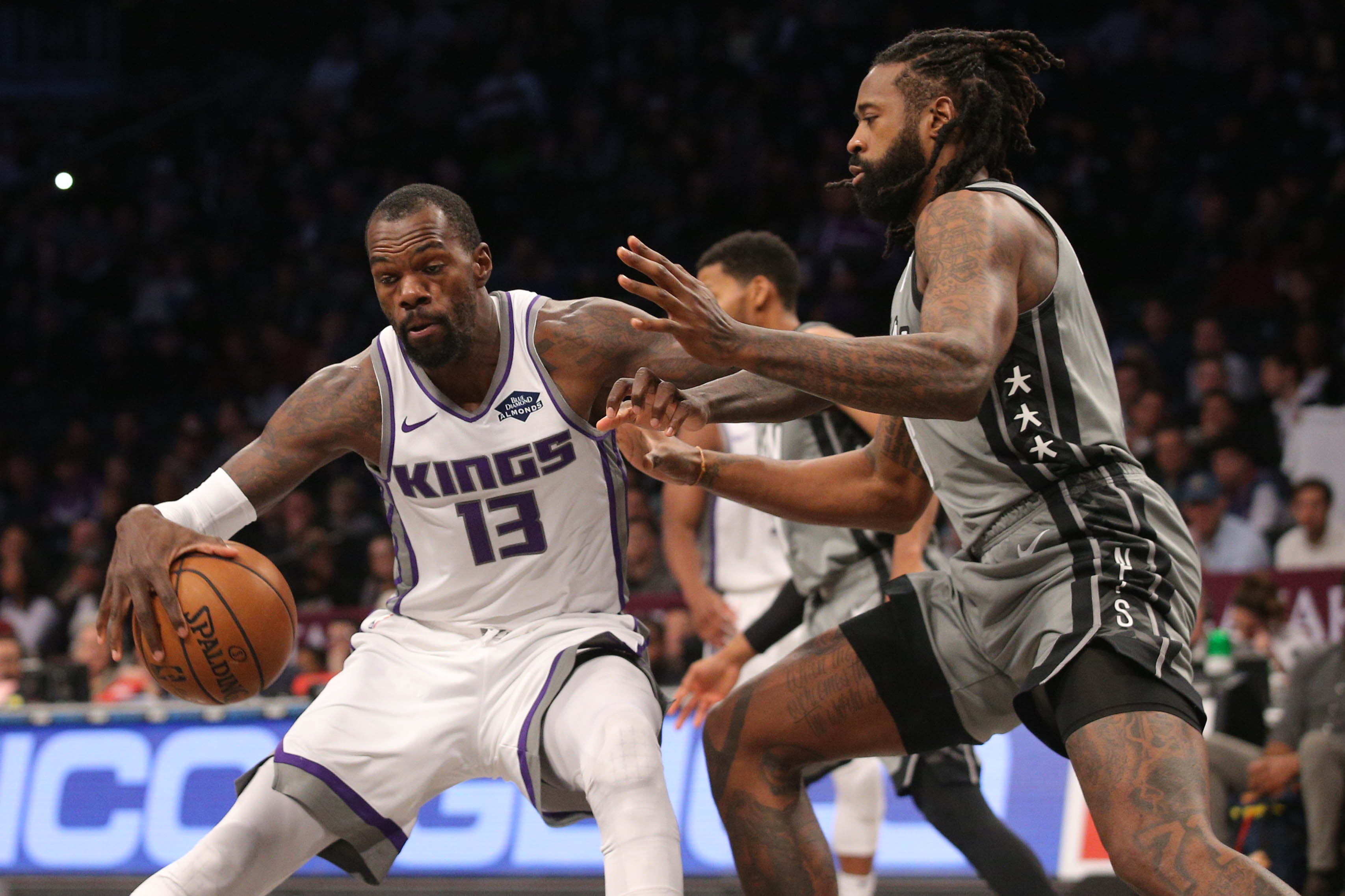 Nov 22, 2019; Brooklyn, NY, USA; Sacramento Kings center Dewayne Dedmon (13) controls the ball against Brooklyn Nets center DeAndre Jordan (6) during the first quarter at Barclays Center.