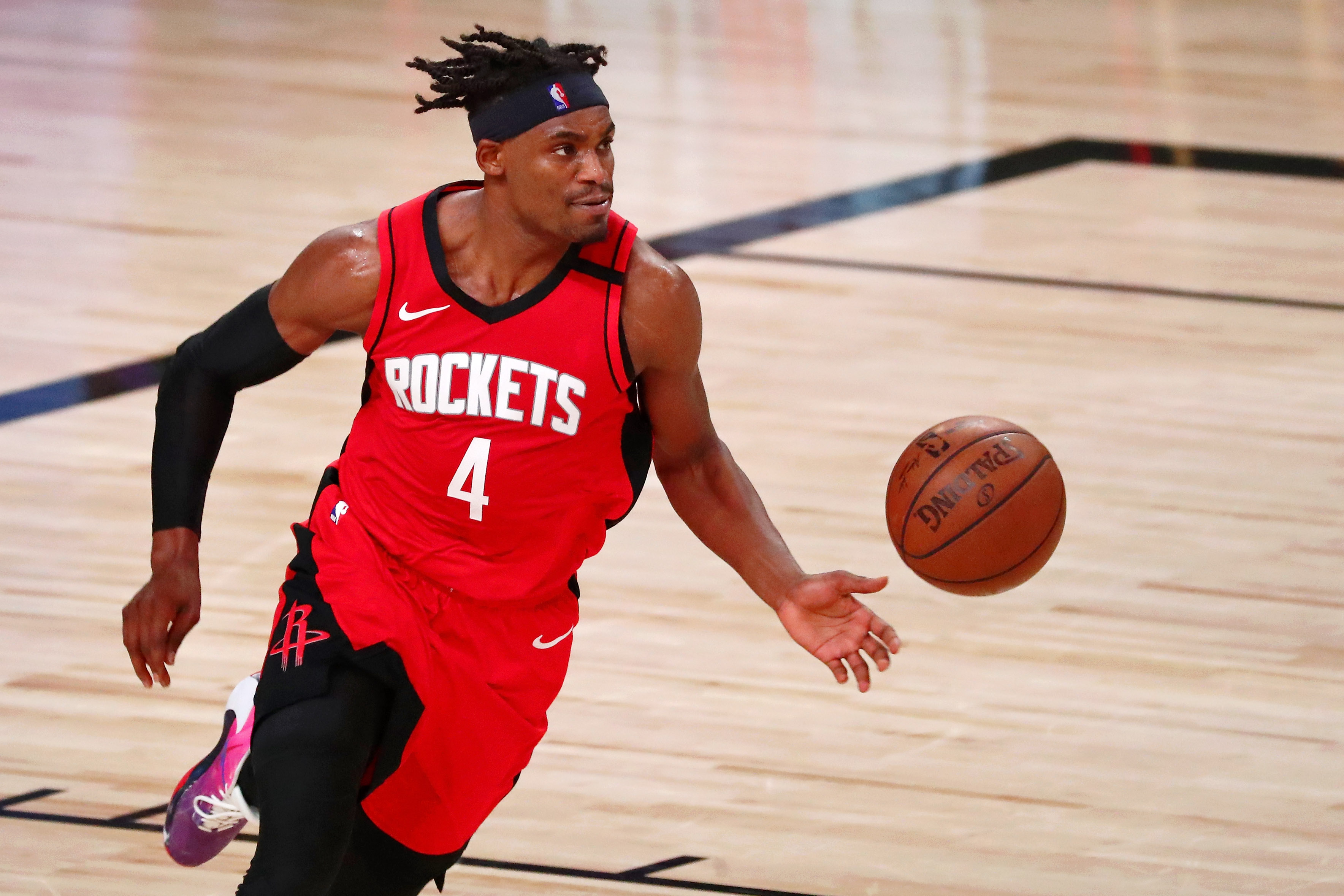 Sep 6, 2020; Lake Buena Vista, Florida, USA; Houston Rockets forward Danuel House Jr. (4) dribbles the ball against the Los Angeles Lakers during the first half of game two of the second round of the 2020 NBA Playoffs at AdventHealth Arena.