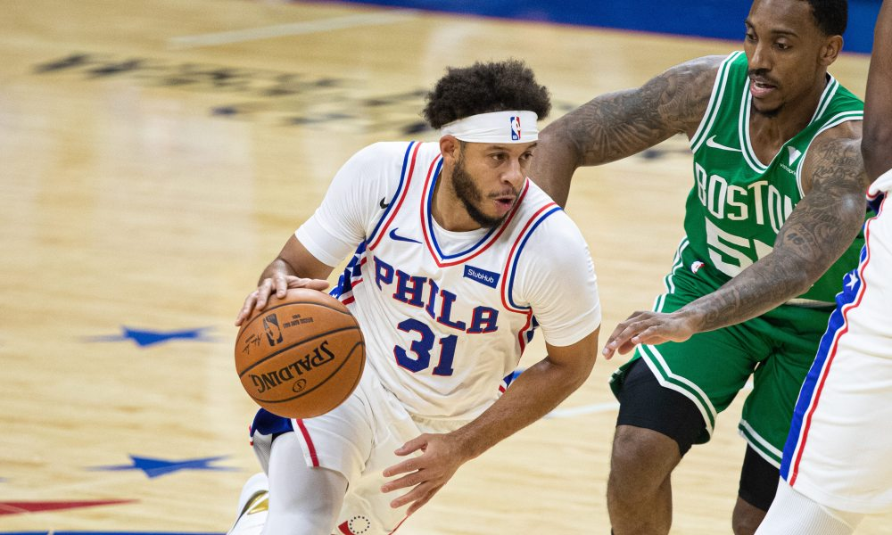 Dec 15, 2020; Philadelphia, Pennsylvania, USA; Philadelphia 76ers guard Seth Curry (31) dribbles against Boston Celtics Jeff Teague (55) during the first quarter at Wells Fargo Center.