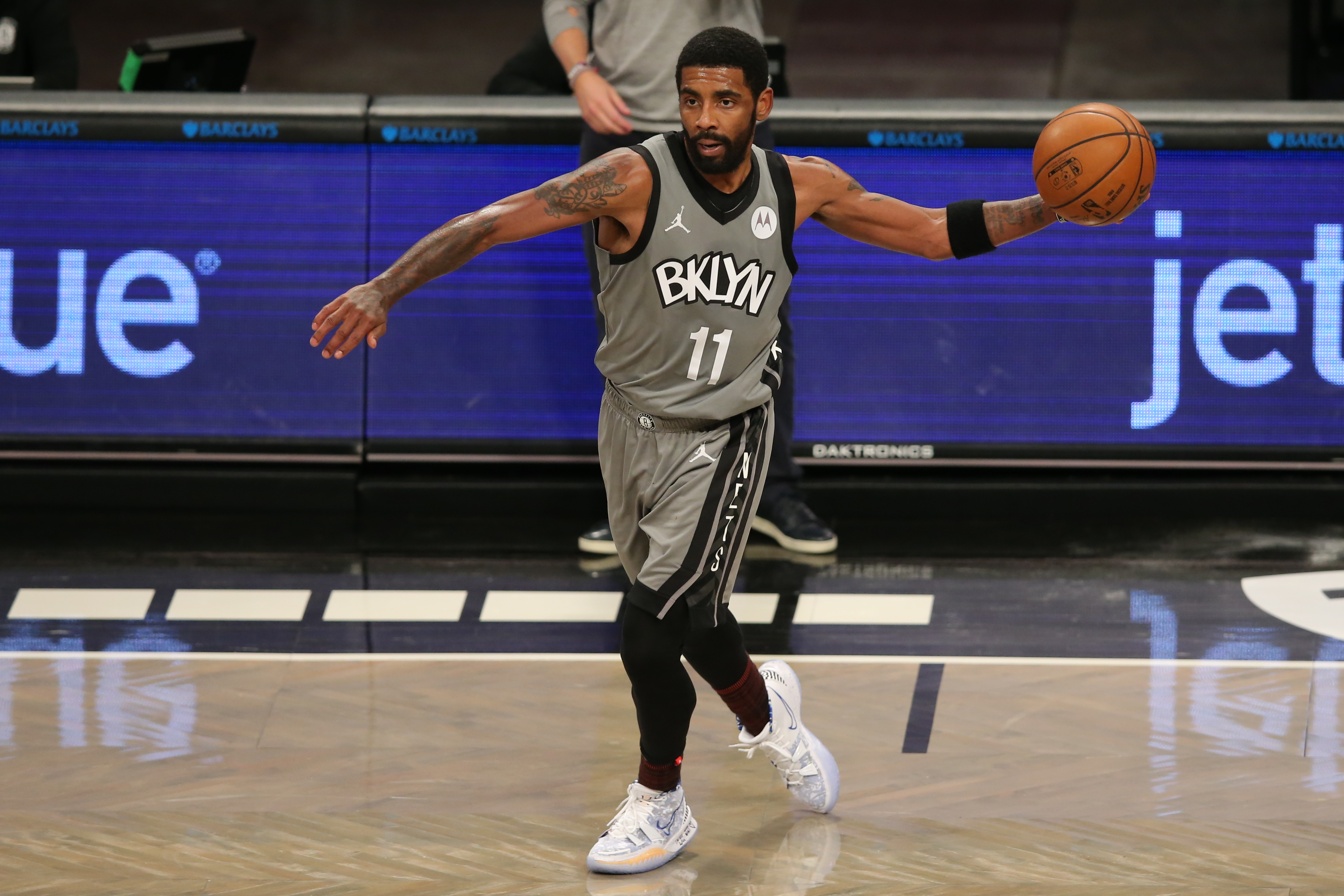 Jan 3, 2021; Brooklyn, New York, USA; Brooklyn Nets point guard Kyrie Irving (11) passes the ball against the Washington Wizards during the second quarter at Barclays Center.