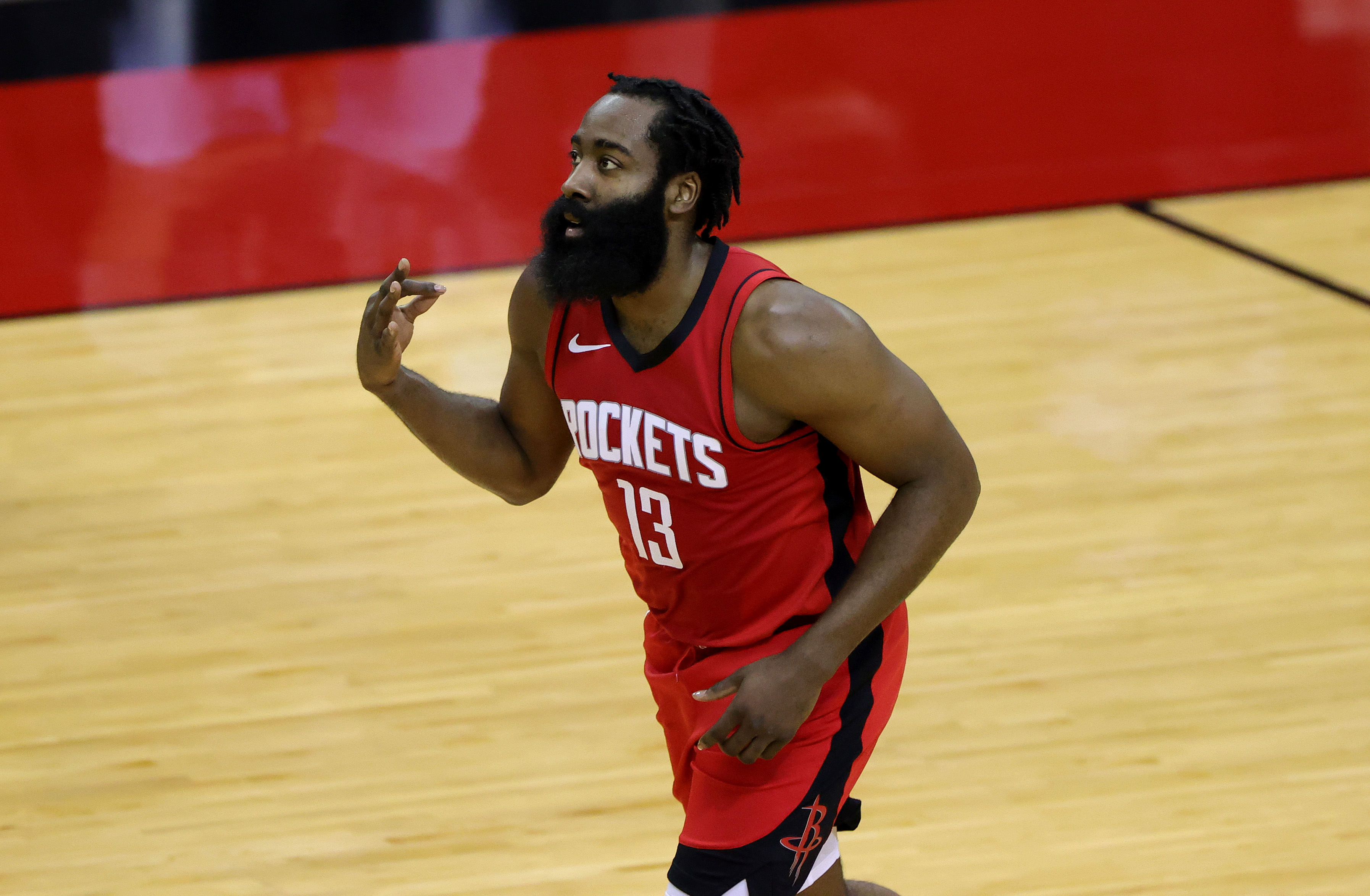 Jan 10, 2021; Houston, Texas, USA; James Harden #13 of the Houston Rockets reacts to a basket during the first quarter of a game against the Los Angeles Lakers at Toyota Center on January 10, 2021 in Houston, Texas.
