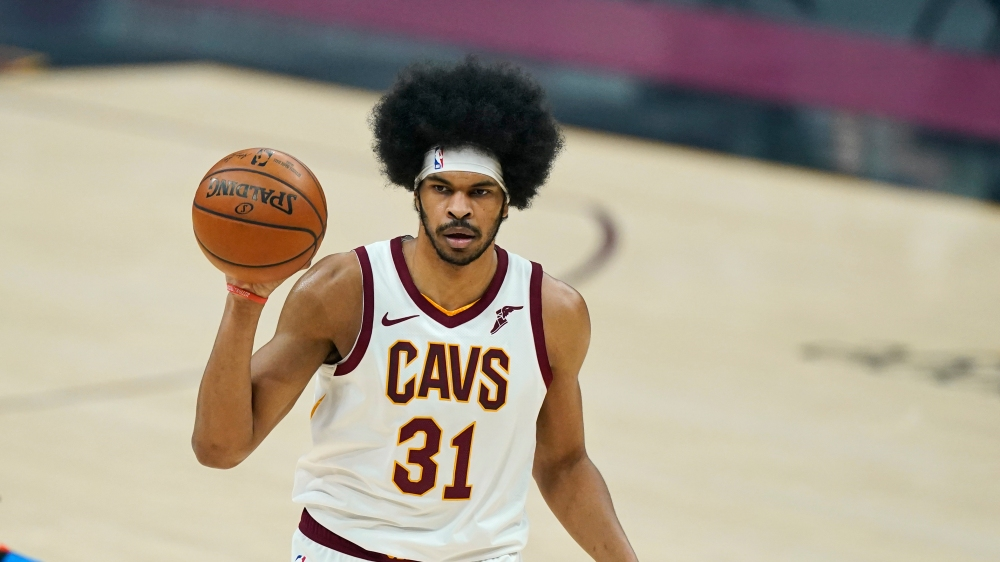 Cleveland Cavaliers' Jarrett Allen looks to pass in the first half of an NBA basketball game against the Oklahoma City Thunder, Sunday, Feb. 21, 2021, in Cleveland.