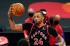 Toronto Raptors guard Norman Powell (24) grabs a rebound against the Philadelphia 76ers during the first half of an NBA basketball game Tuesday, Feb. 23, 2021, in Tampa, Fla.