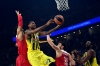Olympiacos' Khem Birch (L) and Kostas Papanikolaou (2nd R) try to block Fenerbahce's James Nunnally (2nd L) as he jumps foe the basket during the first place basketball match between Fenerbahce and Olympiacos at the Euroleague Final Four basketball matches at Sinan Erdem sport Arena, on May 21, 2017 in Istanbul. / AFP PHOTO / BULENT KILIC