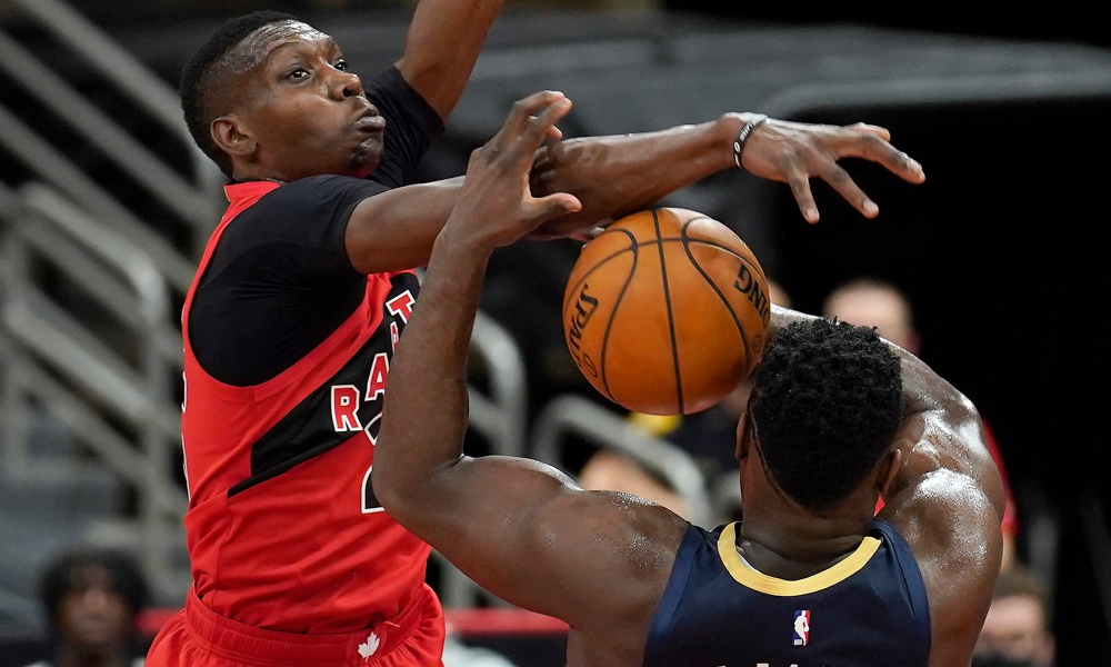 Toronto Raptors forward Chris Boucher (25) blocks a shot by New Orleans Pelicans forward Zion Williamson (1) during the first half of an NBA basketball game Wednesday, Dec. 23, 2020, in Tampa, Fla.